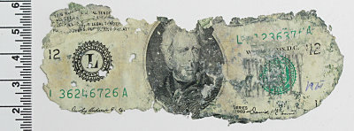 Fig. 1 One of the three D.B. Cooper bills used in this study.