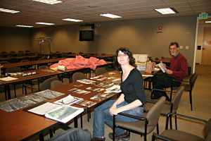 Carol Abraczinskas, University of Chicago and Tom Kaye, Burke Museum examine the D.B. Cooper archive at the Seattle FBI in 2009.