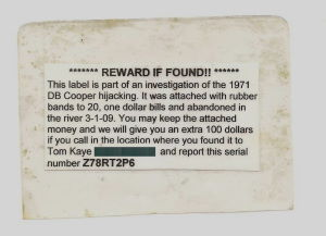 Fig. 2. Reward Tag bound to twenty, one dollar bills with a rubber band and deployed into the Washougal River on 3-2-2009.
